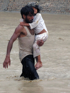 An Afghan man carries a young child to safety during encroaching flood waters in Nari Shahi village, Beshood District of eastern Afghanistan's Nangarhar province July 28. The flooding was caused when more than 6 inches of rain enveloped the area in a few hours. The platoon was returning from a patrol in the district and stopped to help the villagers when they realized the dangers of the situation. (U.S. Army courtesy photo)